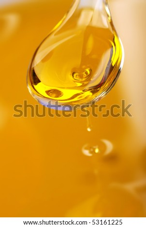 A spoon with an olive oil - stock photo