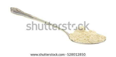A spoonful of soy powder isolated on a white background.