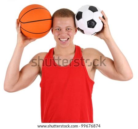 A sports guy holding a football and a basketball, isolated on white