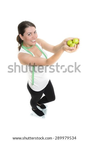A sporty girl holding some apples - stock photo