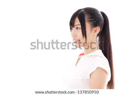 a sporty young asian woman on white background - stock photo