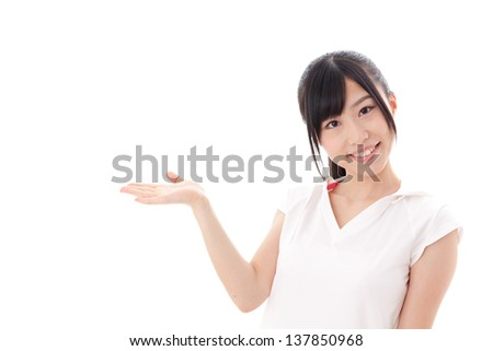 a sporty young asian woman showing on white background - stock photo