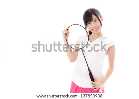 a sporty young asian woman with racket on white background - stock photo