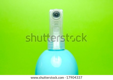 A spray bottle isolated against a blue background
