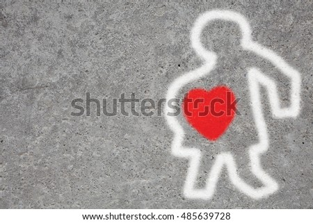 spray paint signage of a pregnant woman with a red heart on a. Black Bedroom Furniture Sets. Home Design Ideas