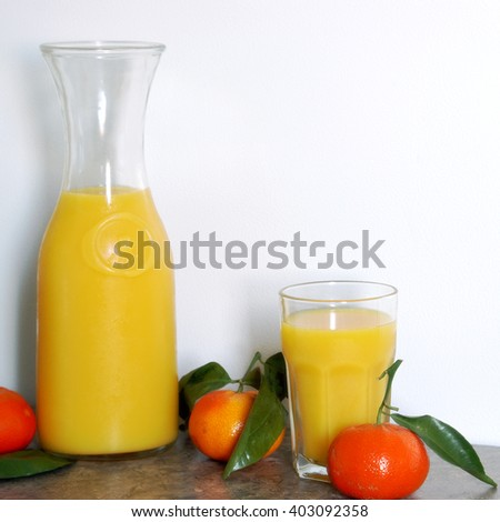 A square format image of a one litre pitcher of refreshing citrus juice blended for a good start to a healthy morning routine. - stock photo