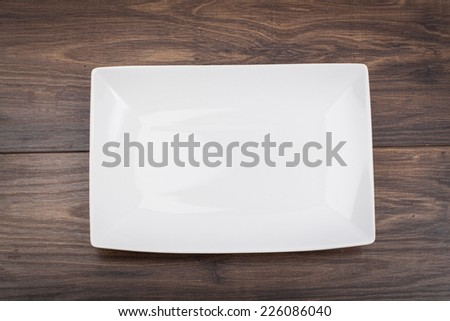 A square plate on the table  - stock photo