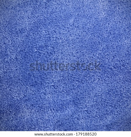a square royal blue background of soft, cozy micro fleece fabric blanket - stock photo