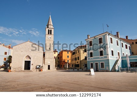 A square with church in the city Fazana - Croatia