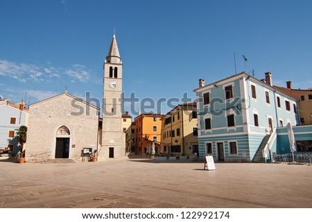 A square with church in the city Fazana - Croatia - stock photo