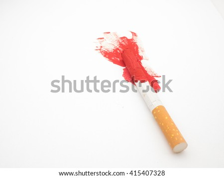 A squash cigarette with red paint over a white background