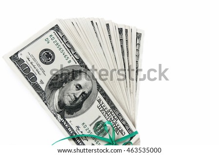 A stack of American dollars tied with ribbon. Isolated on white background.