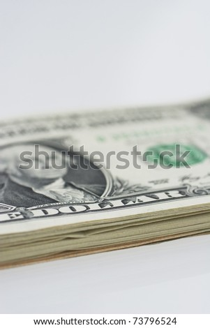 a stack of american one dollar notes. Closeup image with use of selective focus