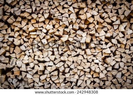 A stack of birch firewood - a natural horizontal background - stock photo