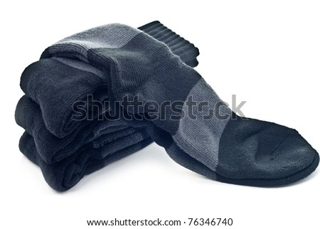 A stack of black socks isolated on a white - stock photo