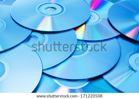 A stack of blue tinted discs - stock photo