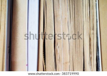 A stack of books in hard and soft cover. - stock photo