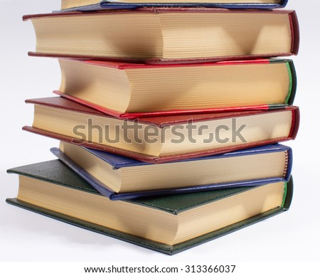 A stack of books isolated on white.