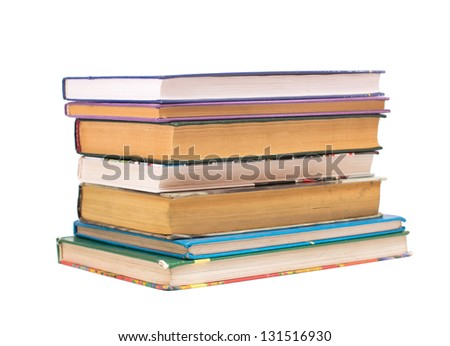 A stack of books of various sizes on a white background.