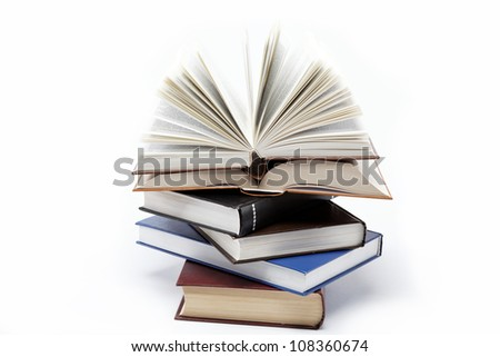 A stack of books on a white background. Open book.
