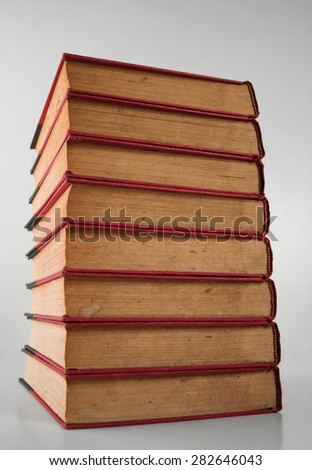 A stack of books over a neutral background