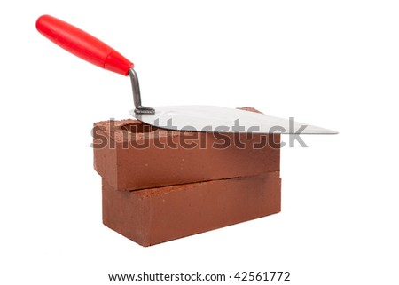 A stack of bricks with a mortar trowel on a white background - stock photo