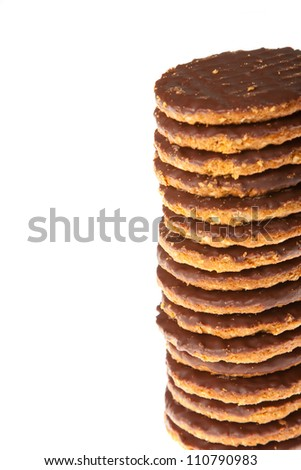 A stack of chocolate and oatmeal biscuits isolated against a white background