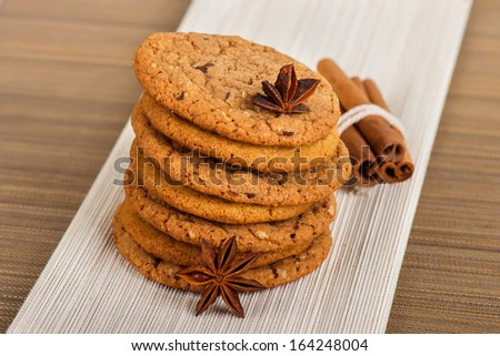 A stack of Chocolate Chip Cookies and cinnamon - stock photo
