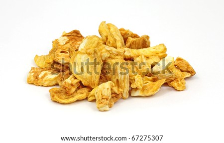 A stack of cinnamon coated dried pineapple chunks.