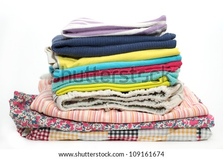 a stack of clothes on white background - stock photo