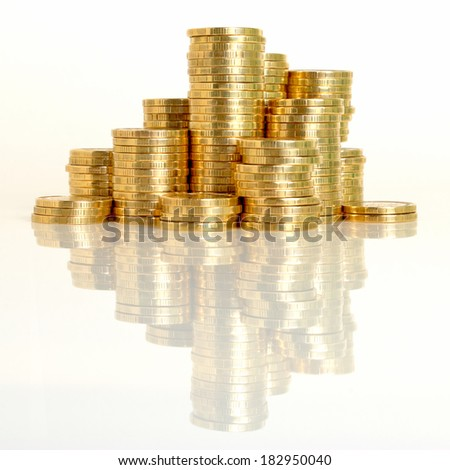 A stack of coins of the yellow metal close-up. - stock photo