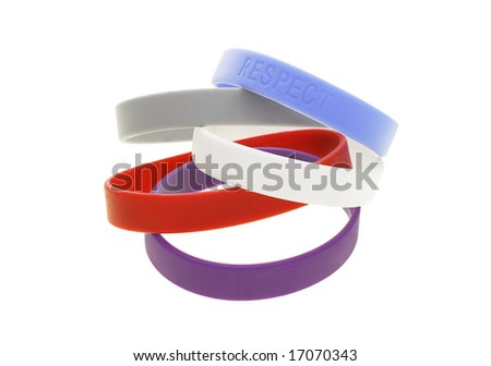 A stack of color wrist bands on white background - stock photo