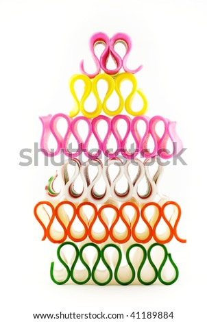 A stack of colorful holiday ribbon candy, isolated on a white vertical background, copy space - stock photo