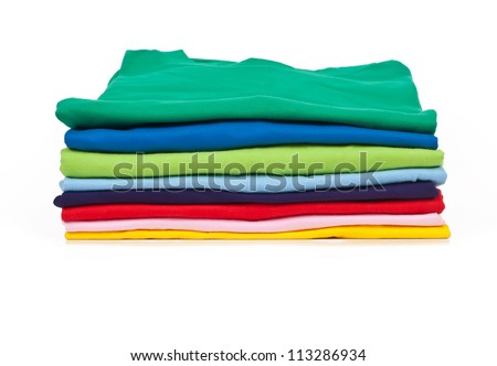 a stack of colorful t shirts, shot in studio - stock photo