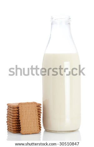A stack of cookies and fresh milk bottle. Shallow depth of field - stock photo