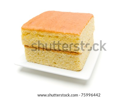 A stack of corn bread slices on a white plate.