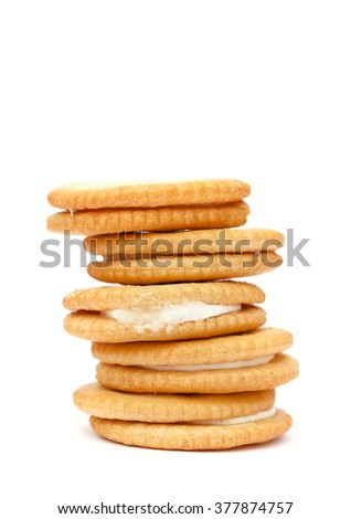 A stack of delicious wheat round biscuits with cream