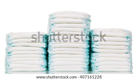 A stack of diapers isolated on a white background. - stock photo