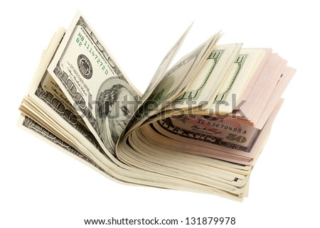 A stack of dollar bills fanned out on a white background - stock photo
