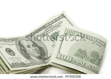 a stack of 100 dollar bills with one folded showing the back