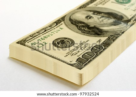 A stack of dollars of 100, on a white background. - stock photo