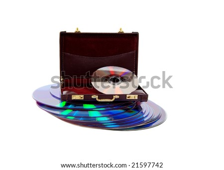 A stack of dvds and a burgundy leather Briefcase used to carry items to the office