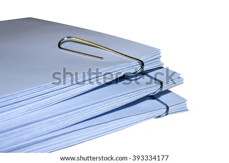 A stack of envelopes with paper clips on white background office supplies