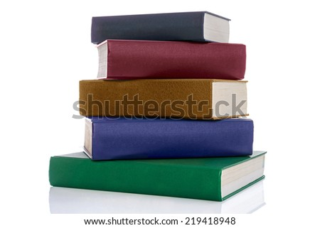 A stack of five hardback reference books with blank spines isolated on a white background. - stock photo