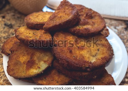 A stack of fried eggplant on a plate - stock photo