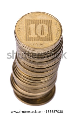 A stack of golden coins isolated on white background. These are 10 Agorot (Singular: Agora), the israeli equivalent of cents. - stock photo