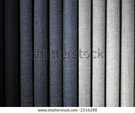 A stack of gray colored book bindings.