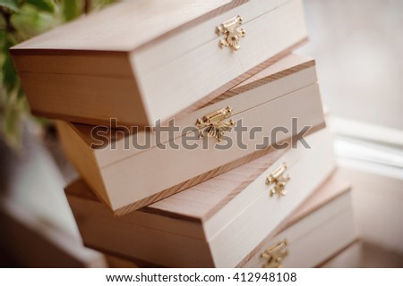 a stack of handmade wooden boxes with locks - stock photo
