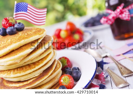 A stack of homemade pancakes with fresh fruit. - stock photo
