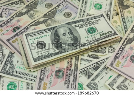 A stack of hundred dollar bills in money background - stock photo